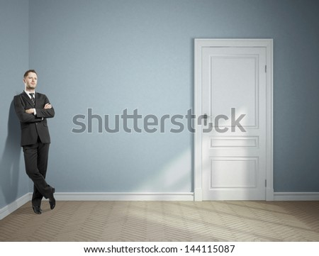 dreaming businessman standing in blue room - stock photo