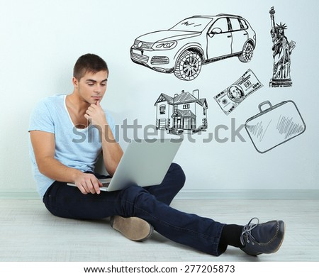 Dreaming concept. Guy sitting on floor in room - stock photo