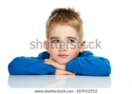 Dreaming little boy in blue cardigan and yellow shirt  - stock photo