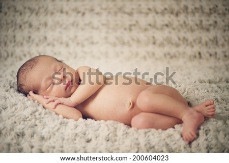 Dreaming Naked Newborn Baby - stock photo