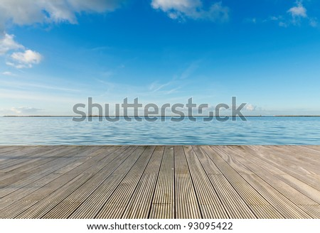 Dreaming on a empty wooden pier - stock photo