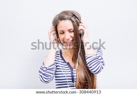 Dreaming woman listening to music - stock photo