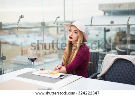 Dreaming young lady,lounge bar,chilling alone and having fun,on bar,look from the city,young woman drinking red wine sitting in a cafe,sensual lovely girl,sensual lady,teen fashion,blogger,Spain - stock photo
