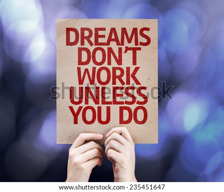 Dreams Don't Work Unless You Do written on colorful background with defocused lights - stock photo