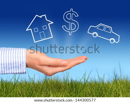 Dreams. House, dollar symbol and car in hand. - stock photo