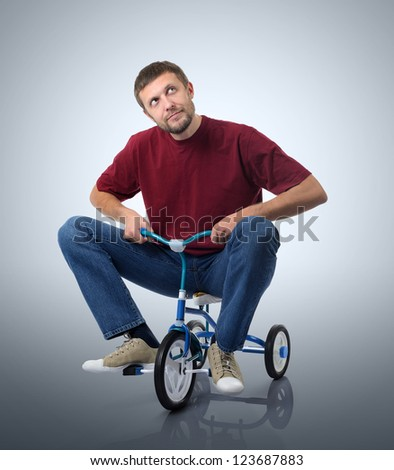 Dreams of a man on a children's bicycle - stock photo