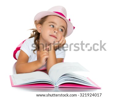 Dreams of adorable little girl lying on the floor and flipping through the book.-Isolated on white background - stock photo