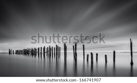 Dreams of Desolation: Fine Art seascape with a decayed pier - stock photo