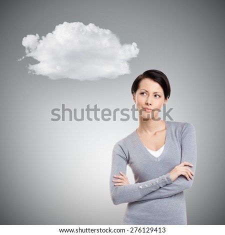 Dreamy mysterious girl, on grey background - stock photo