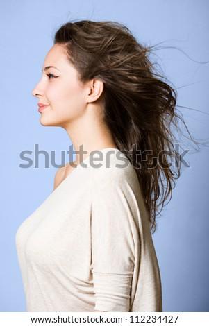Dreamy profile portrait of gorgeous young brunette woman. - stock photo