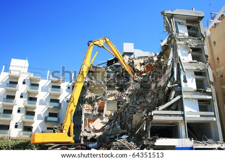 Dredge and destroyed building. - stock photo