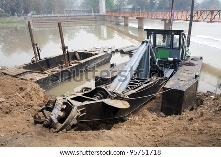 dredge boat - stock photo