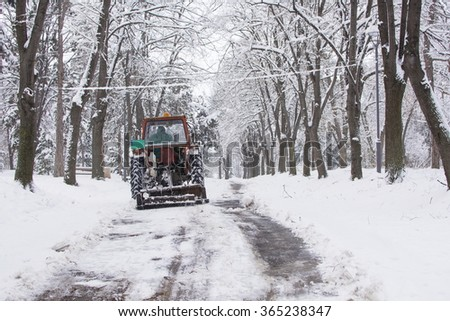 dredge cleaning the roads from the heavy snow - stock photo