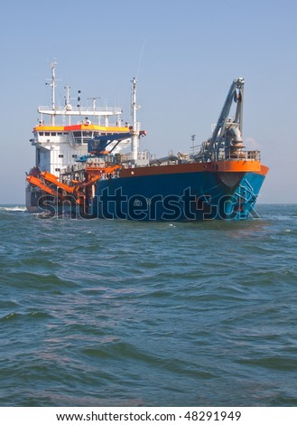 dredger Geopotes 14 Dredging at sea - stock photo