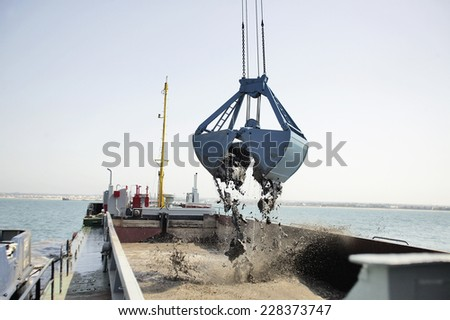 Dredging in a Industrial Harbor near Casablanca in Morocco - stock photo