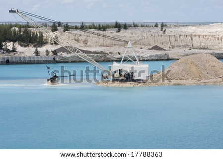 Dredging shipping channel at port in the Bahamas - stock photo