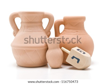 Dreidel and the small oil jug that last for eight days. - stock photo