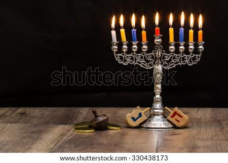 Dreidels and a menorah for Hanukkah. Text-Israel - stock photo