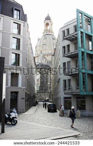 DRESDEN, GERMANY - JUNE, 20th, 2014: Frauenkirche (Church of Holy Marry) seen in combination with modern buildings, famous landmark of Dresden, Germany, on 20th June 2014. - stock photo