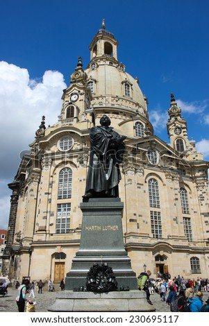 DRESDEN, GERMANY - JUNE, 26th, 2014: Frauenkirche (Church of Virgine Mary) one of most famous landmark of Dresden with Martin Lither monument in front on 26th June 2013. - stock photo