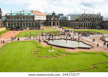 DRESDEN, GERMANY - JUNE, 20th, 2014: Side-top view of Zwinger palace main garden with fountains and grass. Zwinger palace is famous landmark of Dresden, Germany, during sunny day on 20th June 2014. - stock photo