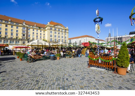 DRESDEN, GERMANY - SEPTEMBER 19, 2015: Unidentified persons visits the street market held in Saturday in the Old Market Square (Altmarkt), visitors have a good time and have a lot of fun - stock photo