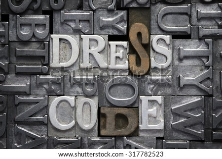 dress code phrase made from metallic letterpress type with letter blocks background - stock photo