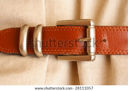 Dress with belt as a concept of saving in the financial crisis - stock photo
