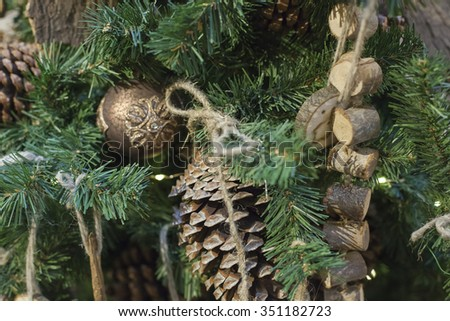 Dressed Christmas tree. Christmas tree. Christmas tree. Christmas toys made of wood. A festive background. Christmas tree cones. - stock photo