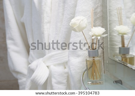 dressing gown in bathroom - stock photo