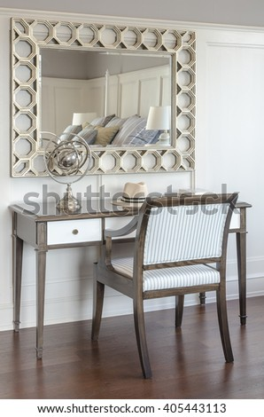 dressing table in luxury bedroom interior with wooden chair and miror - stock photo
