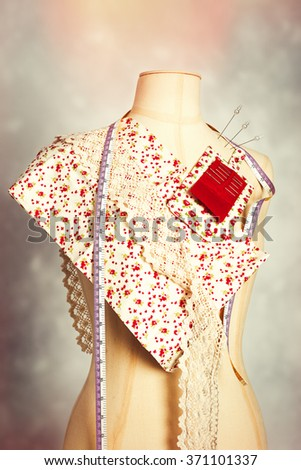 Dressmakers mannequin with colour swatches - stock photo