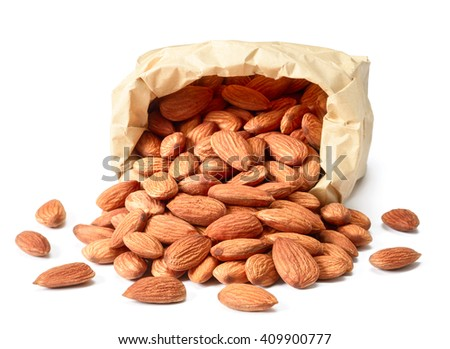 dried almonds in paper bag - stock photo