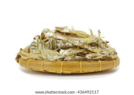 Dried Anchovies Fish in wood basket with isolated on white background - stock photo