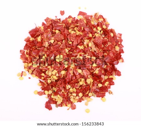 dried and crushed red peppers on white background  - stock photo