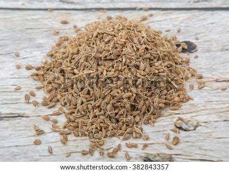 Dried anise seed or aniseed over wooden background - stock photo