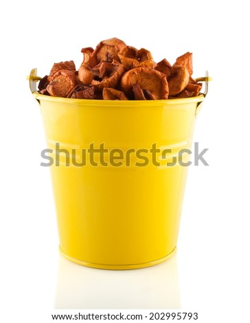 Dried apples in the yellow pail, close up - stock photo