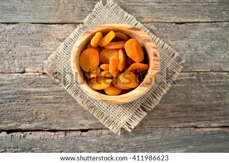 dried apricots on wooden table - stock photo