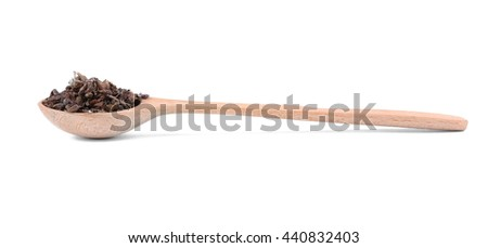 Dried basil (rayhon) in spoon on white background - stock photo