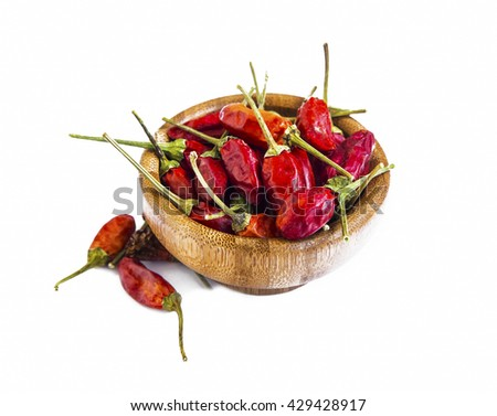 Dried chili flakes in wooden bowl isolated on white - stock photo