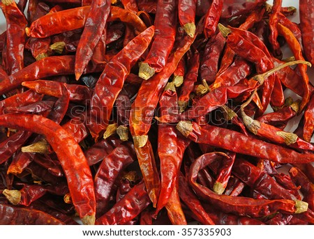 Dried chili peppers background. - stock photo