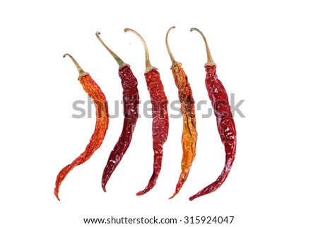dried chili peppers on white background - stock photo