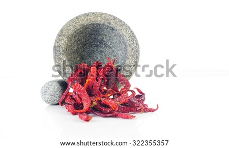 Dried Chillies with mortar on white background - stock photo
