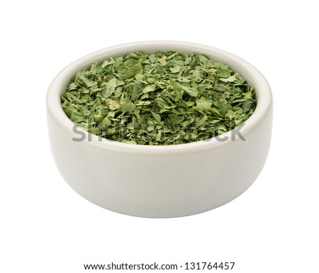 Dried Cilantro in a Bowl isolated on white  with a clipping path. - stock photo