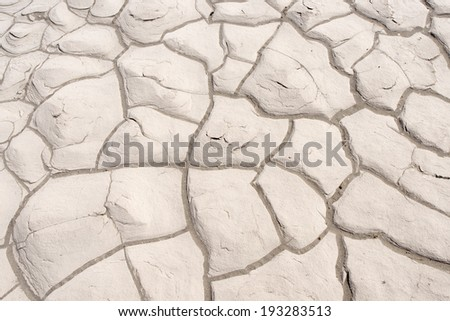 Dried Cracked Mud On A Sand Dune At Stove Pipe Wells In Death Valley National Park, California, USA - stock photo
