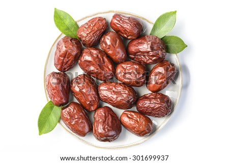 dried date fruit in the plate, top view - stock photo