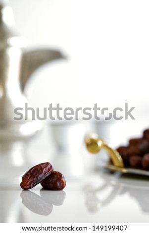 Dried dates and Arabic tea are a prominent feature of the hospitality to be expected in Arabia - stock photo