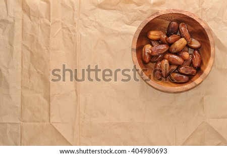 dried dates on Kraft paper. top view - stock photo