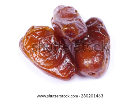 dried dates on white background - stock photo