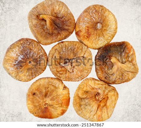 Dried fig fruits. Paper texture. Aged textured photo in retro style - stock photo